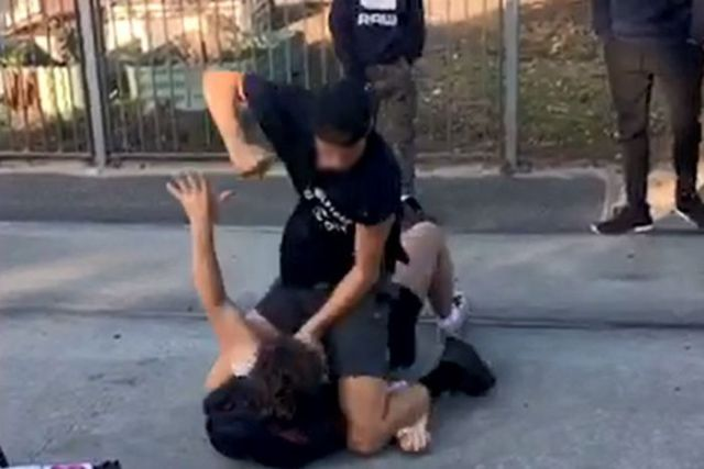 Quinn Lahiff-Jenkins is held to the ground and punched by a teenage boy outside Northcote High School.