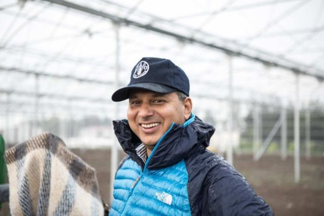 Emergency expert Rajendra Aryal at FAO's greenhouse construction site.