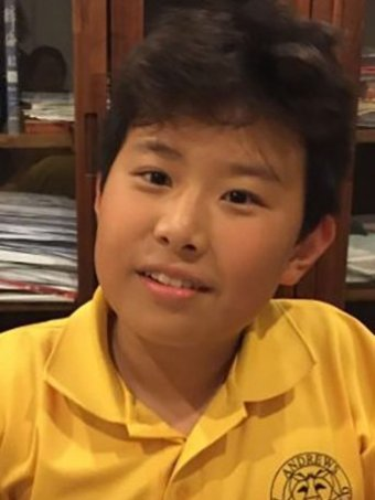 Photo of 12-year-old Asian boy in yellow school shirt, who was taken from Mudgeeraba on Gold Coast about 3:30pm on May 11, 2018