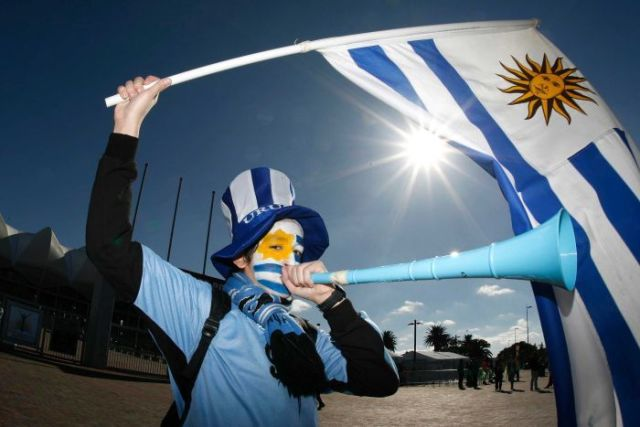 A Uruguay fan blows a vuvuzela before Uruguay v South Korea in Port Elizabeth at World Cup 2010.