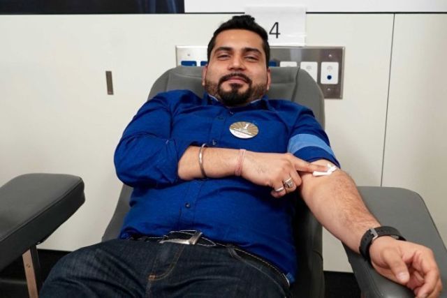Man donates blood at the Red Cross blood donation centre in Sydney