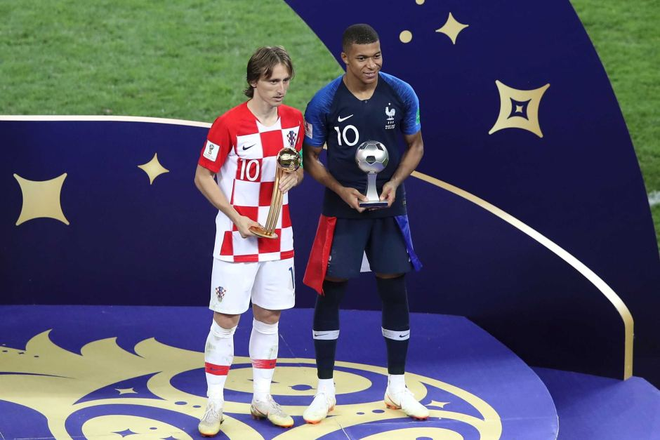 Luka Modric and Kylian Mbappe with Golden Ball and young player     Luka Modric and Kylian Mbappe pose with individual awards