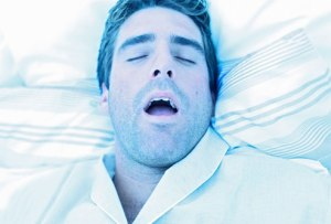 getty_rf_photo_of_man_with_sleep_apnea