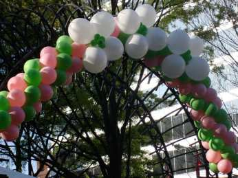 """Dogwood Arts Festival entrance arches say, """"Welcome to Spring."""""""