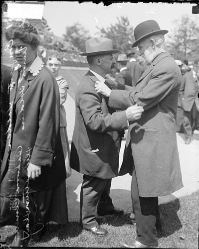 A Confederate and Union veteran meet during a celebration in Chicago, Illinois.