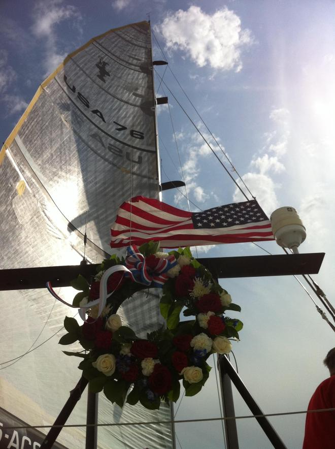 America's Cup yacht USA 76 carries tribute wreath for 9/11 victims.