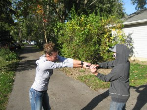 Turning the gun hand palm up, loosens the attacker's grip and gives you better range of motion for the upcoming pull