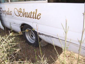 Damage to the bus after the driver pried the sheet metal away from the tire