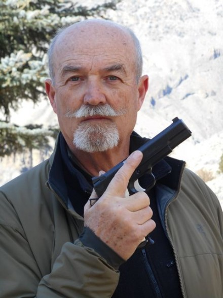 Old-Guy-With-A-Blaster-440x586