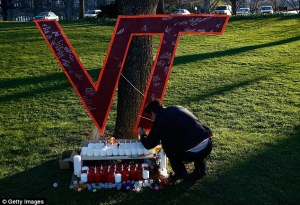 00628AD6000004B0-0-Virginia_Tech_students_write_on_a_memorial_constructed_on_the_Vi-m-2_1435860150002