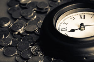 Old clock on many coins