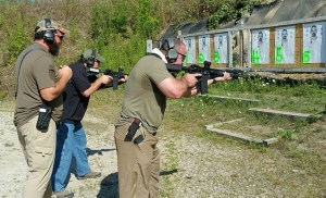 Bryan and I duking it out for first place in one of the shooting competitions