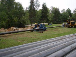 Crews installing snowmaking pipe at Titus Mountain