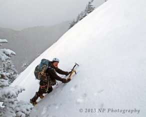 Kevin MudRat MacKenzie on the upper-most slide of Armstrong Mountain's East Face.