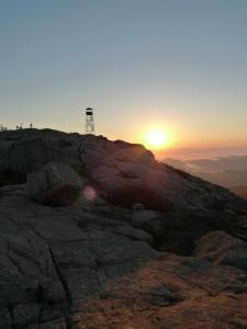 Hurricane Mountain Fire Tower at sunrise  Photo by Michele Drozd