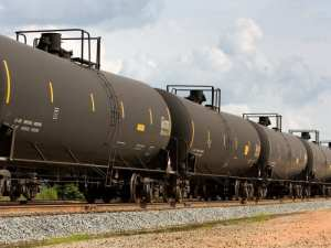 Railroad train of tanker cars transporting crude oil on the tracks earth justice photo
