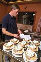 Chef Kevin McCarthy prepares a meal with locally grown food at Dacy Meadow Farm.