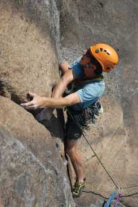 Colin flakes the rope before his climb with the author. Photo by Jim Lawyer