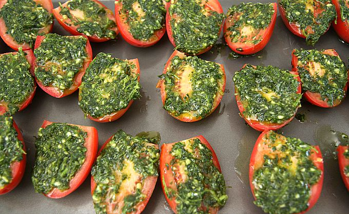 Roasted Tomatoes with Cilantro, Mexican style....eat them with bread, use them as a topping for fish or chicken. or make quesadillas with them . These delicious roasted tomatoes are the perfect addition to any Mexican dish! Save your leftovers (if you have any!) covered with olive oil in a jar in your fridge...I guarantee they won't last long!