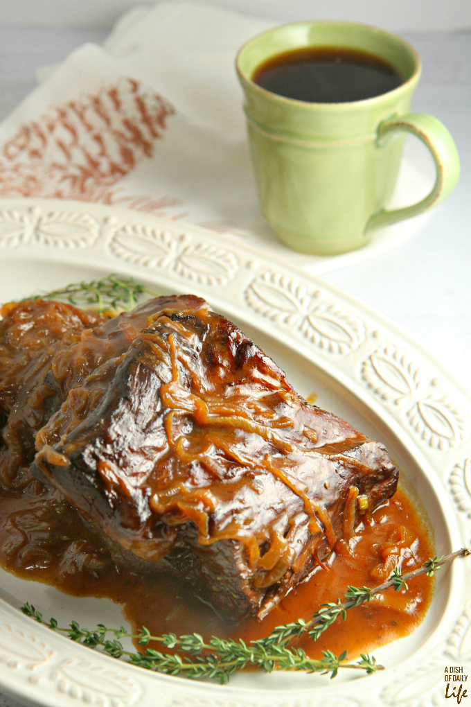 Slow cooked, melt in your mouth Pot Roast with Coffee Gravy and caramelized onions is the perfect comfort food for the chilly winter months!