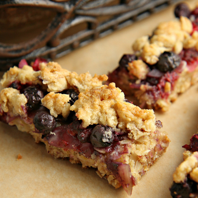This easy Berrylicious Bar Cookies recipe is a delicious snack recipe, sure to be a new family favorite! They're also a great dessert to bring to potlucks, and with the red and blue berries, they're great for the 4th of July too!