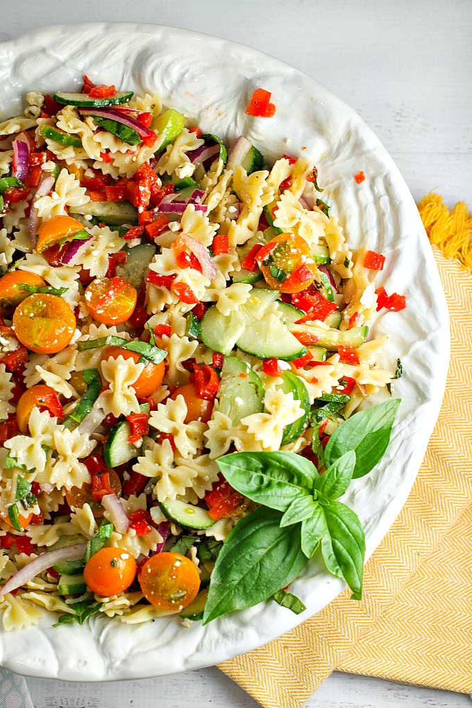 Our Summer Pasta Salad, packed with farmer's market veggies, is the perfect side dish for any potluck or summer BBQ. It's like a burst of summer in every bite! People will be going back for seconds and thirds...everyone will be asking you for the recipe!