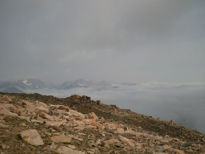 The mountains had trapped a big bank of clouds N of Beartooth Pass. Photo looks NW.