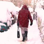 woman trudging through the snow in winter