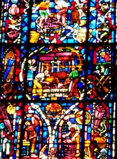 the spectacular Rheims Cathedral where Kings wre crowned, also has stained glass windows depicting the making of wine