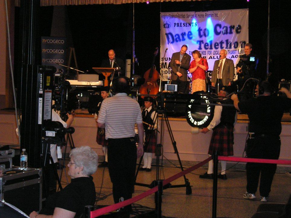 Local Celebrities on stage. Camera Crew on the floor.