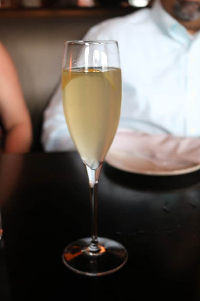 French 75: Tanqueray Gin, fresh lemon juice, and sparkling wine