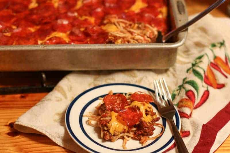 This will be the best Baked Spaghetti Recipe you will ever make. Why Southern? There is no Mozzarella like the traditional Italian versions. Instead, I add in layers of Monterey Jack Cheese, Cheddar Cheese, and Pepperoni. The trio combination along with my homemade meat sauce creates an incredibly wicked good, cheesy spaghetti dish. Once you have tried my Southern Baked Spaghetti Recipe once, it will be a favorite choice to make again and again!