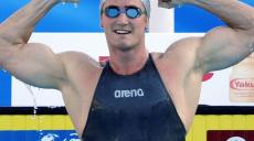Van Der Burgh of South Africa celebrates after winning and setting a world record in the men's 50m breaststroke swimming semi-final at the World Championships in Rome