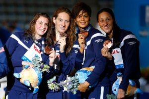 Bronze medalists France's Bonnet, Muffat, Balmy and Lazare at the women's 4x200m freestyle victory ceremony during the World Swimming Championships at the Sant Jordi arena in Barcelona