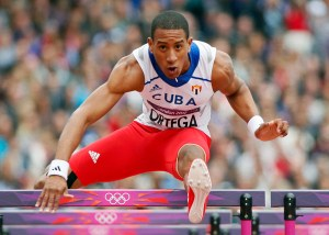 Cuba's Orlando Ortega clears a hurdle on his way to take first place in his men's 110m hurdles round 1 heat at the London 2012 Olympic Games at the Olympic Stadium