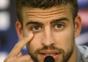 Barcelona's players Gerard Pique gestures during a news conference in Sant Joan Despi near Barcelona