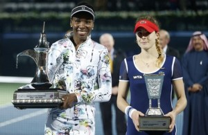 First-placed Williams of the U.S. and second-placed Cornet of Franceh hold their trophies after their women's singles final match at the Dubai Tennis Championships