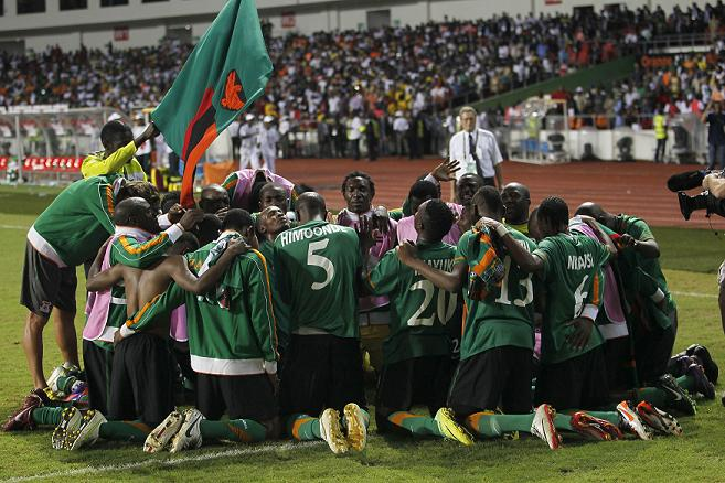 Zambia players celebrate after  their victory against Ivory Coast during their African Nations Cup final soccer match at the Stade De L'Amitie Stadium