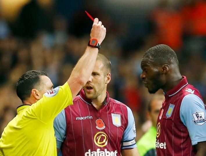 Referee Neil Swarbrick shows Aston Villa's Christian Benteke the red card during their English Premier League soccer match against Tottenham Hotspur at Villa Park in Birmingham