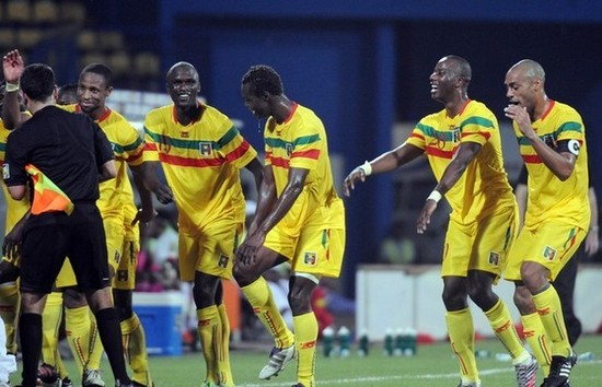 Malia's players celebrate after a goal d