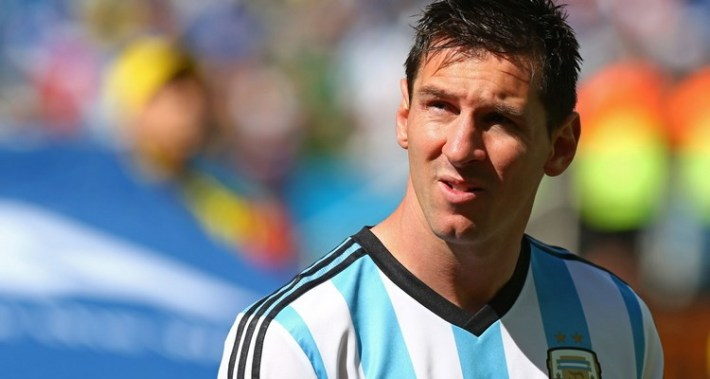 SAO PAULO, BRAZIL - JULY 01:  Lionel Messi of Argentina looks on during the National Anthem prior to the 2014 FIFA World Cup Brazil Round of 16 match between Argentina and Switzerland at Arena de Sao Paulo on July 1, 2014 in Sao Paulo, Brazil.  (Photo by Ronald Martinez/Getty Images)