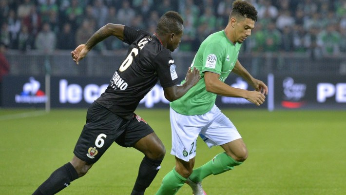 Nice's Ivorian midfielder Jean Michel Seri (L) vies with Saint-Etienne's French defender Kevin Malcuit during the French L1 football match between Saint-Etienne (ASSE) and Nice (OGCN) at Geoffroy Guichard Stadium in Saint-Etienne, central France, on September 27, 2015. AFP PHOTO / JEAN-PHILIPPE KSIAZEK        (Photo credit should read JEAN-PHILIPPE KSIAZEK/AFP/Getty Images)