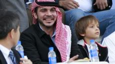 Jordan's Prince Ali bin Al-Hussein (C) and Prince Hashem (R), son of his brother King Abdullah, watch Jordan play against Japan during their 2014 World Cup qualifying soccer match at King Abdullah stadium in Amman March 26, 2013. REUTERS/Muhammad Hamed
