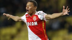 """Monaco's French forward Kylian Mbappe Lottin celebrates after scoring a goal during the French L1 football match Monaco (ASM) vs Troyes (ESTAC) on February 20, 2016 at the """"Louis II Stadium"""" in Monaco.  AFP PHOTO / VALERY HACHE / AFP / VALERY HACHE        (Photo credit should read VALERY HACHE/AFP/Getty Images)"""