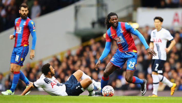 LONDON, ENGLAND - FEBRUARY 21:  Emmanuel Adebayor of Crystal Palace is tackled by Mousa Dembele of Tottenham Hotspur during the Emirates FA Cup Fifth Round match between Tottenham Hotspur and Crystal Palace at White Hart Lane on February 21, 2016 in London, England.  (Photo by Richard Heathcote/Getty Images)