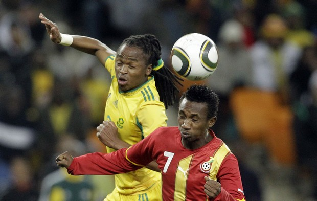 Ghana's Harrison Afful, right, defends against South Africa's Siphiwe Tshabalala, left, during their international friendly match against Ghana at the Soccer City stadium in Johannesburg, South Africa on Wednesday Aug. 11, 2010. South Africa beat Ghana 1-0. (AP Photo/Themba Hadebe)