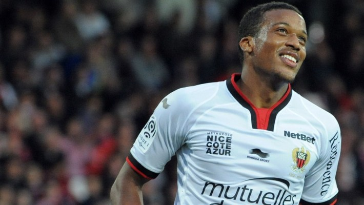 Nice's French forward Alassa Plea celebrates after scoring during the French L1 football match Guingamp vs Nice on October 26, 2014 at the Roudourou stadium in Guingamp, western of France.  AFP PHOTO FRED TANNEAU        (Photo credit should read FRED TANNEAU/AFP/Getty Images)