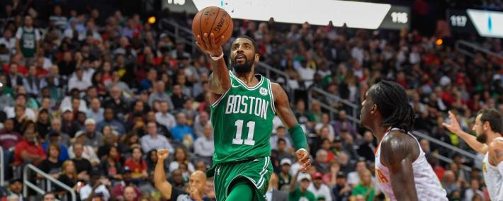 Nov 6, 2017; Atlanta, GA, USA; Boston Celtics guard Kyrie Irving (11) goes to the basket past Atlanta Hawks forward Taurean Prince (12) during the second half at Philips Arena. Mandatory Credit: Dale Zanine-USA TODAY Sports