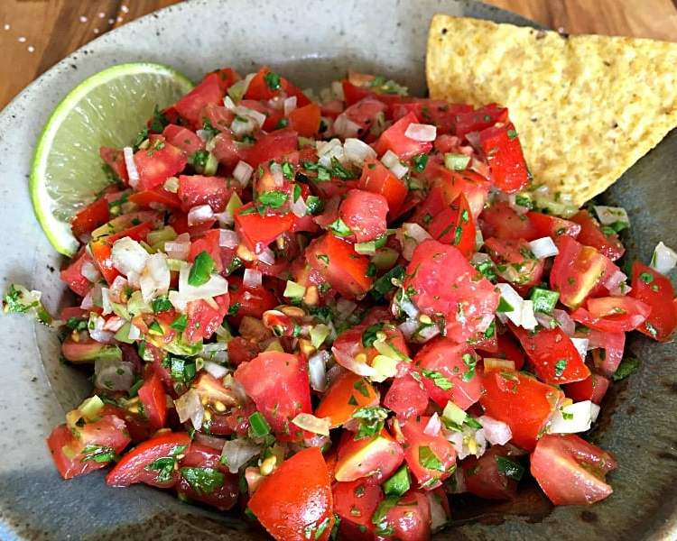 Fresh Tomato Salsa recipe. Light, spicy, tangy hint of lime juice. So easy and worlds better than any store-bought salsa.