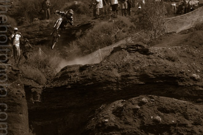 Mountain biker jumps to a wall ride transfer at the Red Bull Rampage event in Virgin, Utah.